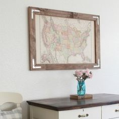 Make a beautiful piece of wall art out of a vintage map and a DIY rustic frame.