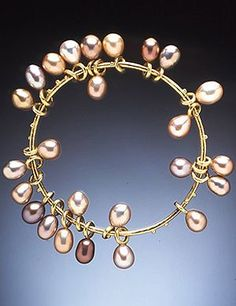 HUGHES BOSCA 18K GOLD JEWELRY | Multi-hued Chinese pearls enhance an 18k gold bangle