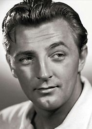 Robert Mitchum.  sensitive with an edge about him was his style.