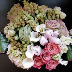 Roses, hyacinths, tulips, calla lilies, tuberoses, folded lily grass, folded ti leaf
