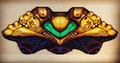 Samus Aran's spaceship from Super Metroid on snes. Made with perler fuse beads