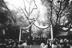 """We got married in a wooded garden, and the guests sat in a semicircle, which made the ceremony feel very intimate. We had a guitarist and a pianist accompany the ceremony. While the guests waited for the bridesmaids to enter, the musicians played Led Zeppelin's """"Going to California,"""" an homage to Brad's West Coast roots."""