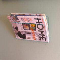 Modern clear wall mounted magazine rack