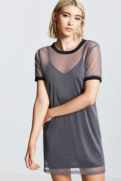 Style Deals - A sheer mesh T-shirt dress featuring a crew neck, short sleeves, ribbed knit trim, cami knit lining, and a mini silhouette.