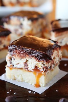 Cookie Dough Billionaire Bars. The most amazing dessert you can bring to a potluck ever. 4 Layers of Shortbread, Salted Caramel Sauce, Cookie Dough and Chocolate Ganache.