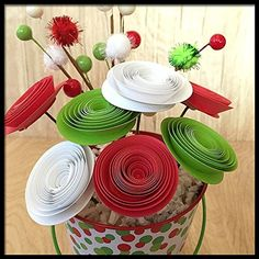 Christmas Hostess Gift Paper Flower Arrangement. This small bouquet makes an excellent hostess gift, gift exchange idea or fun home decor for the holidays! It comes in a 4 inch tall tin with red and green polka dots. It features seven modern, handmade spiral flowers in red, white and green and a decorative spray. The entire arrangement is about 9 inches tall to the tip of the spray.. Please note the estimated creation times. These are only guidelines and I am usually able to ship within a...