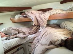 Kids all tucked up for night on boat