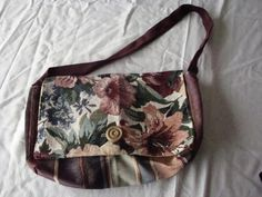 """Purse for on the go offers  lots of smaller pockets.  measures 4""""w X 7""""h X 12""""l.   $40.00"""