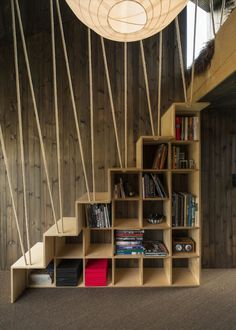 stairs in a backyard cottage in Oslo, Norway, designed by Jarmund/Vigsnæs Arkitekter Stair Bookshelf, Loft Stairs, House Stairs, Bookcase, Wood Bookshelves, Shoe Storage Under Stairs, Stair Storage, Book Storage, Timber Cabin