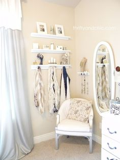 I love this corner! It is a purposeful use of space. I'm worried about have random furniture wedged in my small space, but this style makes the area look distinct from the rest, but still accessible. Home Decor Bedroom, Bathroom Hooks