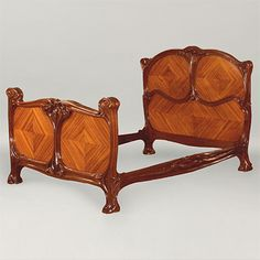 "Eugéne Gaillard - Bed. Carved Mahogany with Rosewood Panels. Designed for Siegfried Bing's Le Maison de L'Art Nouveau, at the Exposition Universelle, Paris, France. Circa 1900. 65-1/2"" x 84"" x 54-1/2"" (Headboard) x 37-1/2"" (Foot Board)."