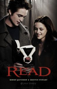 I like how they are both holding the book written about them and the expression shown on their faces.