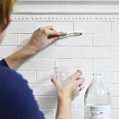 For stubborn stains on ceramic-tile surfaces, scrub grout with a stiff-bristled toothbrush dipped in vinegar and watch it whiten before your eyes.CAUTION: Vinegar can harm marble and other natural stone surfaces, so avoid using on these materials. Test a small, unobtrusive area first if you want to be extra careful.