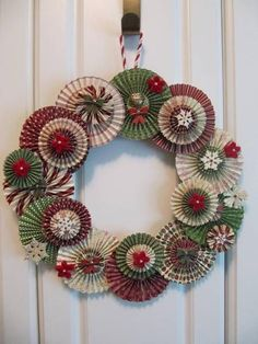 Great idea--a wreath made from paper rosettes! Use a scoring board (or die) and any patterned paper to create the rosettes.