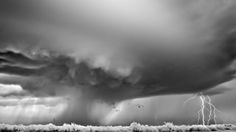 """Few people realize that storms and clouds are often categorized into a variety of taxonomies — including families, genera, and even species — not unlike like plants and animals. Last Thursday, American photographer Mitch Dobrowner was named the 2012 Sony World Photography Awards Photographer of the Year, in recognition of a remarkable series of images entitled """"Storms,"""" which captures these various phenomena on film."""