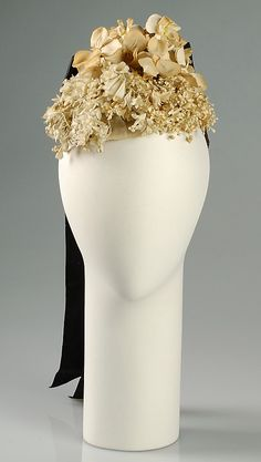 Cocktail hat  House of Schiaparelli  (French, 1928–1954)  Designer: Elsa Schiaparelli (Italian, 1890–1973) Date: fall 1939 Culture: French Medium: Cotton, silk