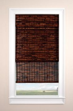 Blinds.com Brand Economy Woven Wood Shades in Elisa Mahogany. These wood roman shades form soft folds when raised and are offered with an optional liner for increased light control. Find them at Blinds.com
