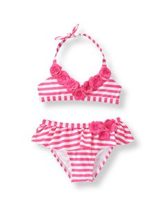 With charming floral accents, our striped swimsuit is poolside perfect. Pieced ruffle accent completes the look.