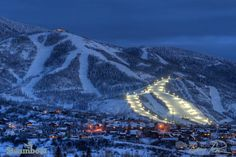 The night skiing lights turn on at dusk at Steamboat Ski Resort in Steamboat Springs, Colorado.