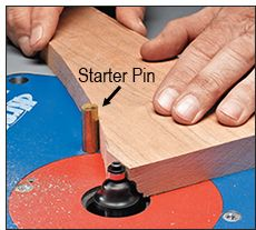 If you need to rout a profile on the edge of a curved piece, you won't be able to use the router table fence. That's where you need a router table insert plate that's equipped with a start pin. It helps you to start your cut without the bit grabbing your workpiece. You just rest your workpiece against the pin, and then rotate the piece into the bit until the edge makes contact with the router bit bearing.