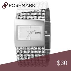 DKNY Mesh Crystal Bracelet Watch ✨Reposh✨ DKNY Mesh Crystal Bracelet Watch. Stainless steel. Needs battery. There are no stones missing. I bought this on Poshmark but my daughter didn't want it so I am reselling it DKNY Accessories Watches