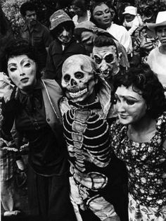 A Spooky Vintage Halloween Photo of a Skeleton and Masks