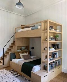 This bunk bed by Amber Lewis creates so much storage space! Created for her latest project, this bunk bed was combined with a bookshelf and drawers. Plus, unlike typical bunk beds, this one has a small set of stairs that lead to the upper level.