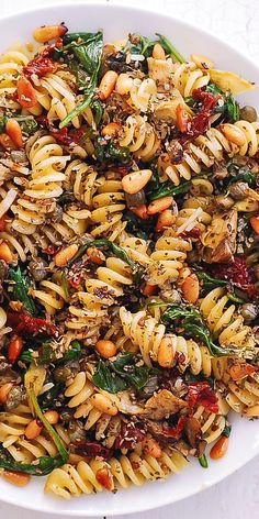 Italian Pasta with Spinach Artichokes. Italian Pasta with Spinach Artichokes Sun-Dried Tomatoes Capers Garlic and Pine Nuts! This meatless vegetarian pasta dish has only 8 ingredients and takes 30 minutes to make! Vegetarian Pasta Dishes, Vegan Pasta, Vegetarian Recipes, Cooking Recipes, Healthy Recipes, Meatless Pasta Recipes, Light Pasta Recipes, Spinach Pasta Recipes, Spinach Artichoke Pasta