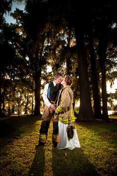 Kelly+Trevor in the fire fighter gear on their wedding day! #fire fighter #wedding #gear www.robertmphotography.com