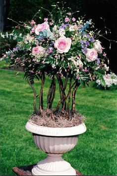 Curly willow are the base for this Topiary. Perfect for the buffet table by www.flowersandstuff.com