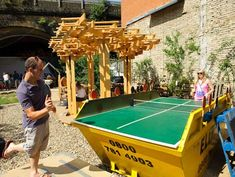 American landscape architect Heather Ring of the Wayward Plant Registry has transformed a disused site in Bankside, London, into a public garden with the introduction of apple trees, allotments,  a timber pavilion, and a table-tennis table in a skip
