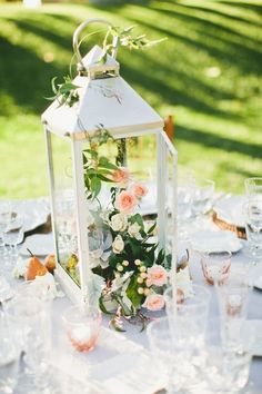 Chic lantern centerpiece with blooms on garden party table