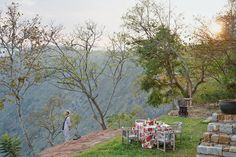 Loulou Van Damme stands at the edge of her hotel's property in the Palani Hills of Tamil Nadu, India.