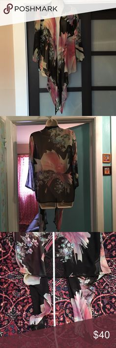 Status by Chenault Black Floral Kimono Top M Here is a black floral kimono by Status by Chenault. It is a size medium, and features a large overall floral print with big pink flowers! 100% polyester. Status by Chenault Tops