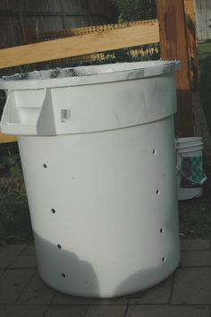 Growing red potatoes in a garbage can. happymoneysaver.com