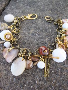 Neutral colored shells, stones and glass beads dangling from antiqued brass chain make this a funky and 'jingly' design!  $29 #jewelry