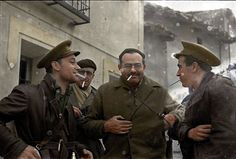 Ernest Hemingway in Spanish civil war. The man in the center with the cig
