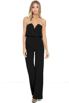 You'll be absolutely irresistible when you're wearing the Power of Love Black Strapless Jumpsuit! Stretch knit shapes a strapless bodice with a fluttering tier, hidden V-bar, and no-slip strips. A high, fitted waist tops relaxed wide leg pants. Hidden back zipper/hook clasp. As Seen On Sunita of @sunitav_!
