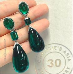 41.15 and 39.23 carats of emeralds