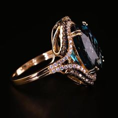 This fabulous ring features an oval Deep Sea Blue Topaz traced in sparkling Vanilla Diamonds® further framed in luscious Chocolate Diamonds®. Crafted of Strawberry Gold®, the ring has a total diamond weight of carat. Jewelry Kits, Jewelry Case, Jewelry Stores, Kids Jewelry, Men's Jewelry, Jewelry Bracelets, Bohemian Jewelry, Vintage Jewelry, Unique Jewelry