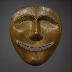 AN ESKIMO WOOD MASK, POINT HOPE    composed of carved wood, depicting the moon.