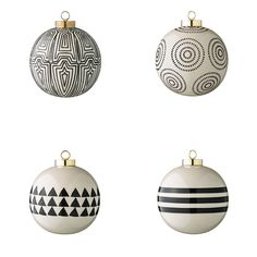 Bring chic style to your Christmas tree with this set of four ceramic ball ornaments. In black and cream, these ornaments feature four different geometric designs and are crafted from stoneware cer...