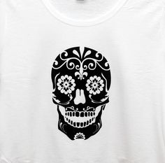 Skull tee.  Heat pressed in black flock. Available in various colours and sizes. Shop@sewthereembroidery.co.uk