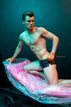 Heat of the night by photographer Gavin Harrison. Model Ryan Noble, shorts by N2N bodywear.