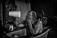 Matt Black :: A jobless man bathes in a bucket. Lanare, California, 2014. From 'Geography of Poverty'