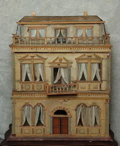 Christian Hacker dollhouse this rare circa dollhouse was made by Christian Hacker of nuremburg, Germany. It is the only known example in existance with the unusual recessed third floor and flower pots on the balconies. Antique Dollhouse, Dollhouse Dolls, Dollhouse Miniatures, Dollhouse Design, Haunted Dollhouse, Modern Dollhouse, Miniature Houses, Miniature Dolls, Fairy Houses
