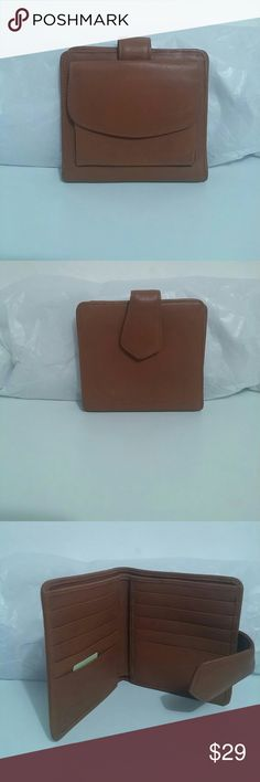 Genuine leather Dooney & Bourke wallet. Authentic tan leather Dooney & Bourke wallet. Outside snap closure compartment. Inside has a main cash compartment and 10 card slots!! Also has 2 inside hidden pockets. Dooney & Bourke Bags Wallets