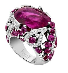 Piaget tourmaline known as rubellite set in a ring with other rubilittes and diamonds making fancy shoulders and framework