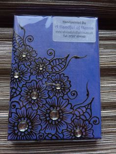 henna canvas made by my friend tracy - i have 3 of these (different designs) around my house. totally lovely!
