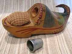 wooden shoe pin cushion with thimble holder.